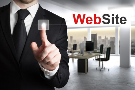 sourcecode: businessman in modern office pushing button website