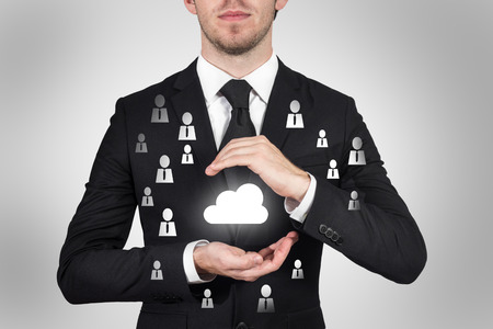 businessman protecting cloud symbol with hands internet community Stock Photo