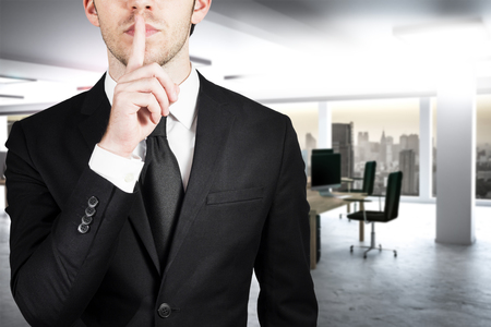 businessman in large clean office with finger on lips asking for silence 3d illustration Banque d'images - 116294871