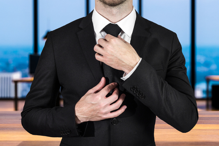 businessman correcting his tie in large empty office 3D Illustration