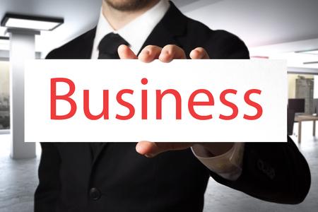 businessman in large modern office interior holding paper card business - 3D Illustration