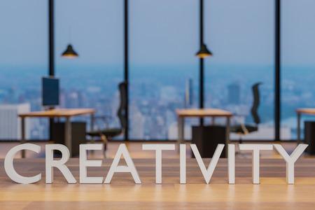 creativity logo on clean wooden desk in modern office with skyline view 3d rendering 版權商用圖片