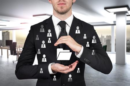 businessman protects folder data symbol with his hands malware 版權商用圖片