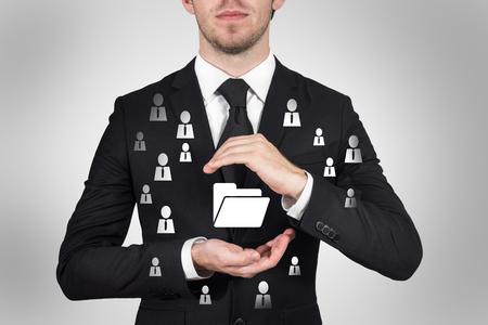 businessman protects folder data symbol with hands malware 版權商用圖片