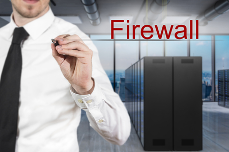 businessman in large modern server room writing firewall in the air, 3D Illustration Stock Photo