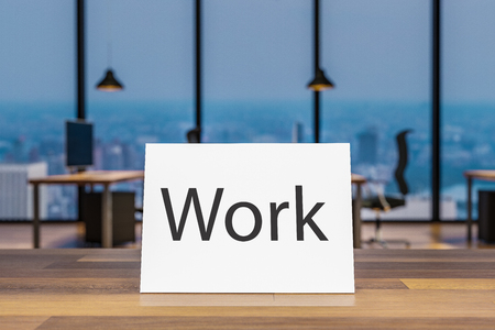 Close up of wooden table with small paper sign work, blurry colorful office interior background, 3D Illustration