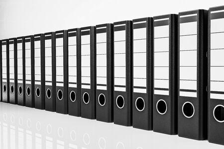 large row of black office folders, conceptual archive 3D Illustration Stok Fotoğraf - 131817125
