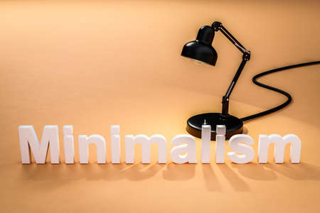 industry style desk lamp on orange colored surface with lettering minimalism concept minimalism; 3D Illustration Stock Photo