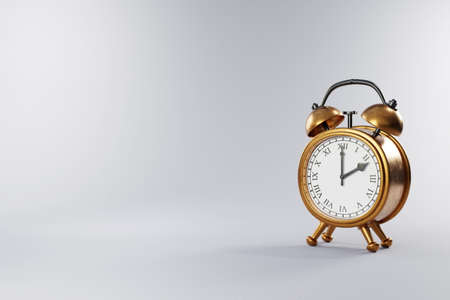 old vintage retro style alarm clock with golden metal body and grey neutral background; copy space; 3D Illustration