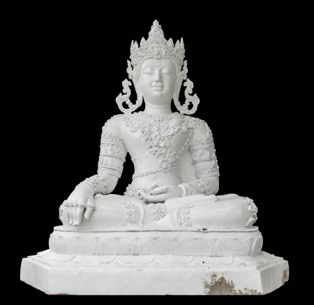 lanna: white Lanna king statue isolated in black background Stock Photo