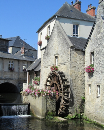 normandy: A waterwheel on the river Aure in the historic centre of Bayeux, Normandy,  France