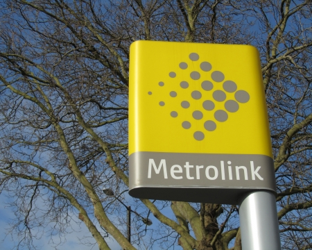 tramline: Manchester, England, March 30: The destinctive yellow Metrolink sign and emblem found at all tram stations in Manchester, England, in March 2013. The metro system is currently being expanded.