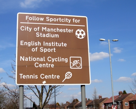 hosted: MANCHESTER, ENGLAND, APRIL 6: A road sign listing a number of sporting attractions found in the Sportcity district of Manchester on April 6 2013. Manchester hosted the 2002 Commonwealth Games there.