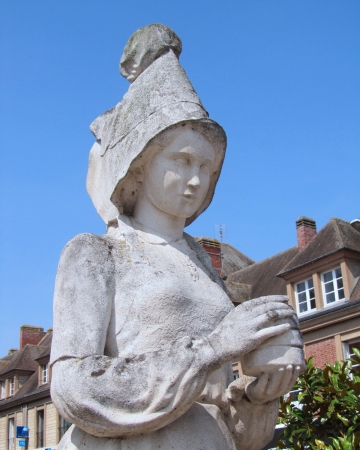 invented: VIMOUTIERS, FRANCE, JULY 27: The statue of Marie Harel in Vimoutiers on July 27th 2012. Madame Harel is reputed to have invented the world famous camembert cheese.