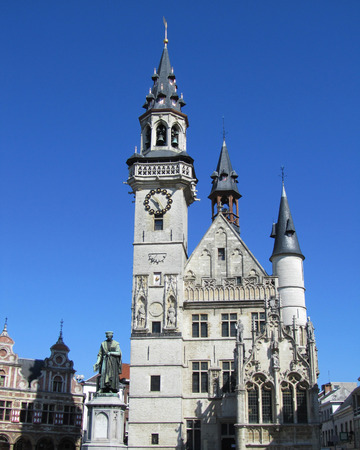 main part: The iconic clock tower  belfort  and Alderman s house in Aalst situated on the main market square  Part of the building dates to from the 13th century and is one of the oldest in the low countries                                  Stock Photo