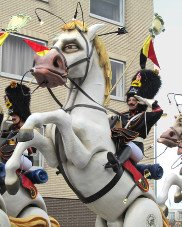 intangible: AALST, BELGIUM, MARCH 03 2014  Unknown Aalst costumed carnival participant, rides on a float in the annual parade  The Carnival is recognized by UNESCO as an event of Intangible Cultural Heritage
