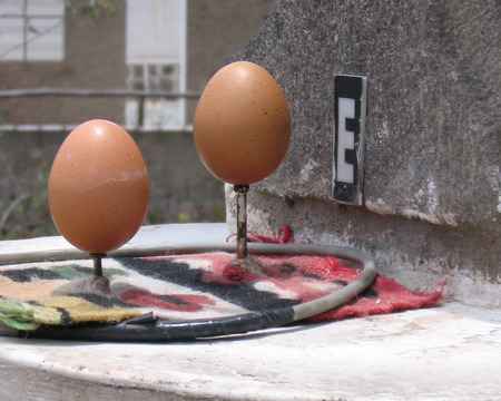 equator: MITAD DEL MUNDO, ECUADOR: 6 OCTOBER 2005. Eggs balancing on top of nails, which is only possible at the equator. A huge tourist attraction, half a million people visit Mitad del Mundo each year. Editorial