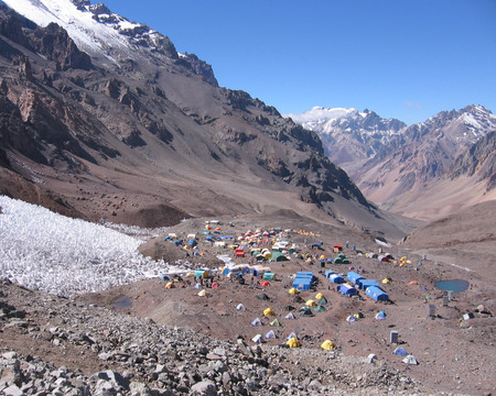 aconcagua: Spectacular view overlooking the brightly colored tents of Aconcagua base camp, Plaza de Mulas, in Argentina in South America.