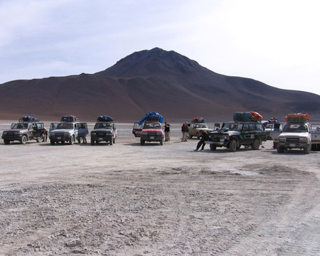 laden: POTOSI, BOLIVIA, 7 JANUARY 2006: Tourists and their heavily laden jeeps waiting to leave during a trip to Salar de Uyuni and Potosi, a popular tourist destination in Bolivia.