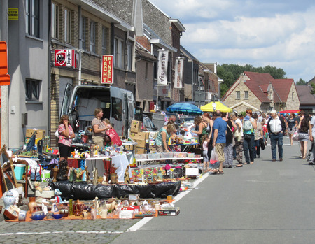 secondhand: AALST, BELGIUM, AUGUST 16 2015: Flea Market in the streets of Herdersem near Aalst. A type of bazaar, it has become a popular pastime to sell merchandise at or visit to buy secondhand goods.