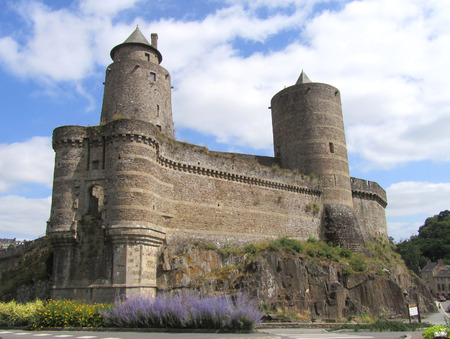impressive: FOUGERES, FRANCE, JULY 13 2015: Part of the impressive defensive wall of the medieval Fougeres Castle in Normandy in Northern France.