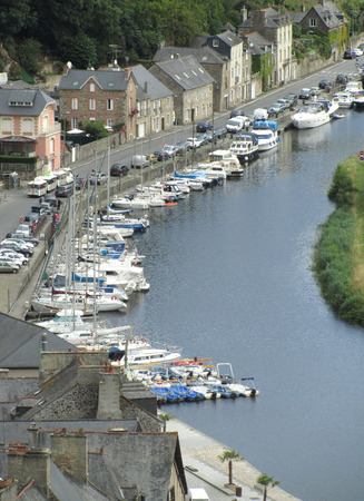 rance: DINAN, FRANCE, JULY 20 2015: A view of the port of Dinan on the river Rance in Brittany, France, in the summer.  The old town of Dinan is a popular tourist destination. Editorial