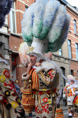 headress: AALST, BELGIUM, FEBRUARY 7 2016: Unknown member of the Aalsterse Gilles, during the annual carnival parade in Aalst, which is a UNESCO recognized event of Intangible Cultural Heritage. Editorial