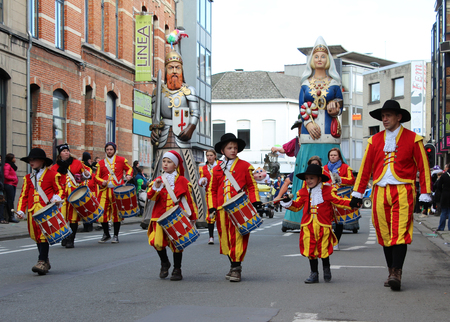 recognized: AALST, BELGIUM, FEBRUARY 7 2016: Unknown participants and aalsterse giants, during the annual carnival parade in Aalst, which is a UNESCO recognized event of Intangible Cultural Heritage.