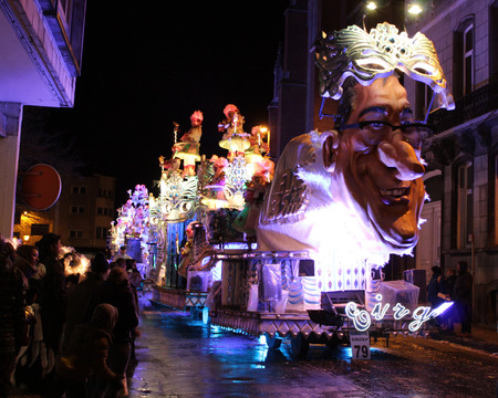 intangible: AALST, BELGIUM, FEBRUARY 7 2016: One of the brightly lit floats during the annual carnival parade in Aalst, which is a UNESCO recognized event of Intangible Cultural Heritage. Editorial