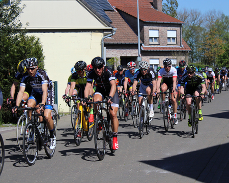 passtime: AALST, BELGIUM MAY 5 2016: Amateur riders from various cycle clubs compete in a bike race through the streets of Aalst, in East Flanders Belgium. Cycling is a very popular sport in Belgium.