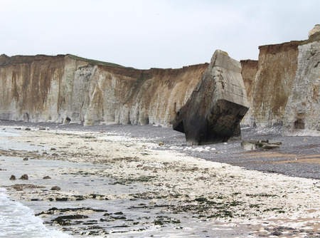 ww2: The striking chalk coastline near Quiberville, in Normandy France. The area has heavily eroded cliffs and derelict German WW2 concrete bunkers.