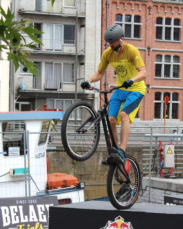 profesional: AALST, BELGIUM, 3 JULY 2016: Profesional trialbiker Andy Masschelin demonstrates his skills at the annual sport market in Aalst. He is a member of the well known Belaey Trials Team.