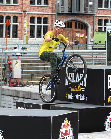 wesley: AALST, BELGIUM, 3 JULY 2016: Profesional trialbiker Wesley Belaey demonstrates his skills at the annual sport market in Aalst. He is a member of the well known Belaey Trials Team.