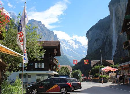 oberland: LAUTERBRUNNEN, SWITZERLAND, JULY 29 2016: The picturesque village of Lauterbrunnen in the Bernese Oberland, a hugely popular tourist destination in Switzerland.