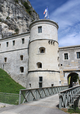 jura: LEAZ, FRANCE, AUGUST 3 2016: Part of the lower fort of Fort lEcluse, situated in the Rhone valley, in the Jura mountains of France. A popular tourist destination.