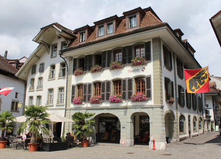 17th: THUN, SWITZERLAND, JULY 28, 2016: The attractive facade of 17th century townhall of Thun, a town in the Bernese Oberland in Switzerland. It is a popular tourist destination. Editorial
