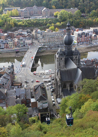 DINANT, BELGIUM, OCTOBER 13 2017: View from the citadel down to the Meuse River and Our Ladys Church in Dinant, Namur. Dinant is a popular tourist destination in Wallonia with panoramic views.