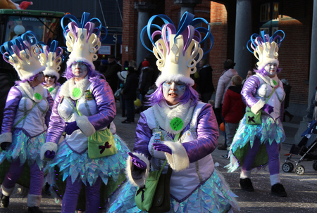 AALST, BELGIUM, 12 FEBRUARY 2018: Unknown Aalst carnival participants celebrate during the annual street parade.