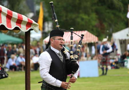 CRIEFF, SCOTLAND, 21 JULY 2018: Unknown competitors during the piping competition at the Lochearnhead highland Games near Crieff in Scotland. An annual event promoting Highland culture and traditions. Sajtókép