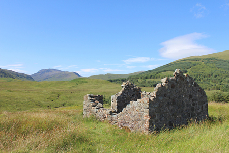View of the beautiful landscape of Glen More on the Isle of Mull near the A849, with an abandoned croft in the foreground.