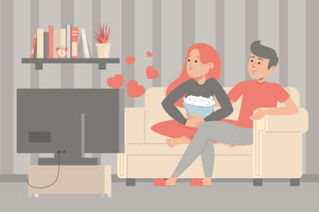 Couple watching romantic movie together at home. Woman holding pop corn and crying. Leisure activities at home.