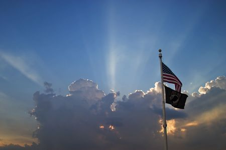 the american flag in front of a sunset.