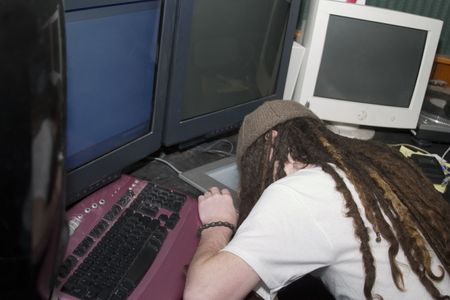 a guy asleep at the computer