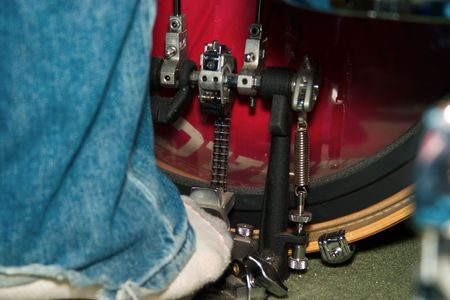 a foot hitting a kick drum in the studio.