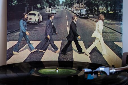 Naples, Italy 20 August 2019. Turntable with the Abbey Road vinyl of the Beatles in the background.