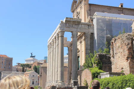 In the ancient city of Rome stands the temple of Saturn, visible today in the imperial forums. Stock fotó