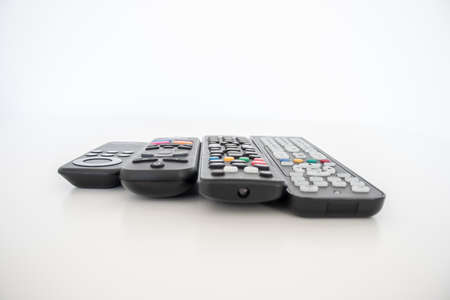On a white background the remote controls, one for each device used.