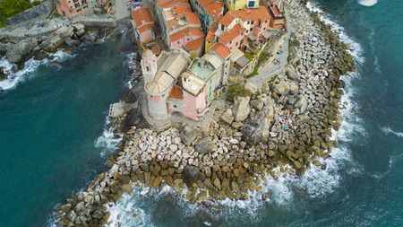 city park boat house: Aerial shooting with drone on Tellaro, famous Ligurian village near the Cinqueterre, small colored houses built on the cliff by the sea