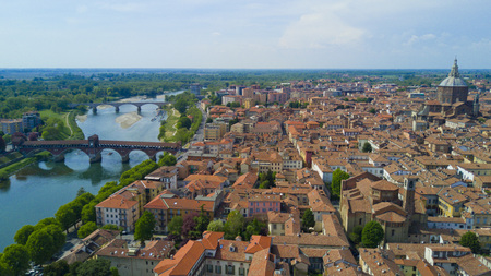 Aerial shooting with drone on Pavia, famous Lombardy town near the Ticino river in northern Italy