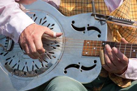Street guitarist playing a metallic guitar called dobro Stock fotó
